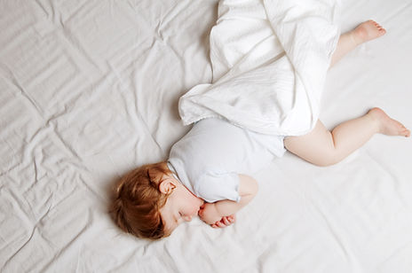 a baby or toddler sleeping