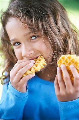 girl eating waffle.jpg