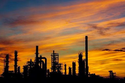 silhouette-gas-distillation-tank-oil-refinery-plant-tower-column-tank-oil-petrochemistry-i