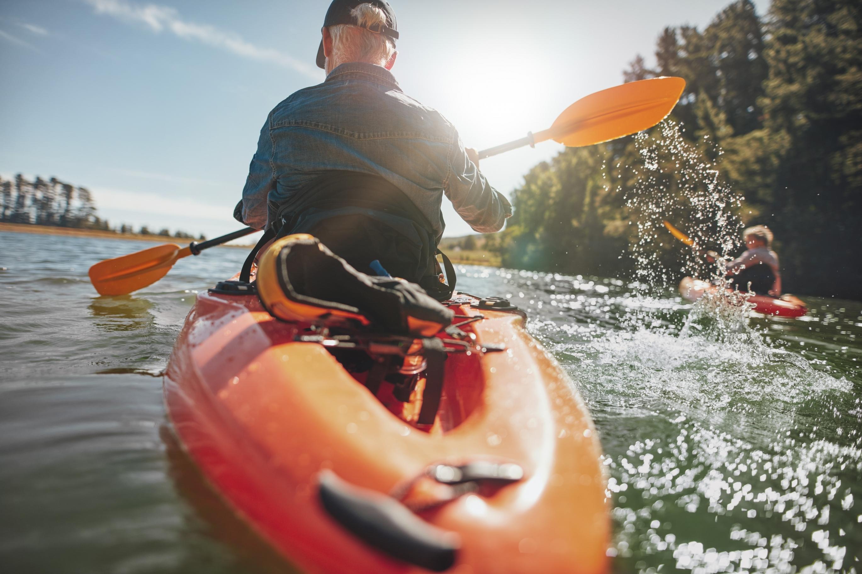 Man In Kayak Paddling On Lake