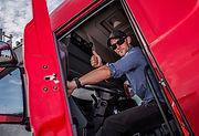 Happy Caucasian Semi Truck Driver Showin
