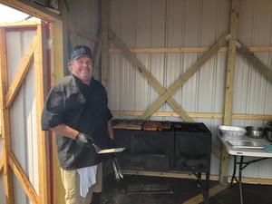 Sam standing near bbq grill.jpg