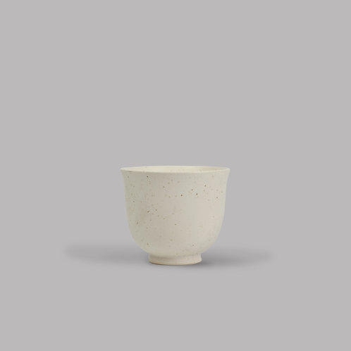 white speckled teacup