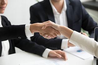 female-hands-shaking-group-meeting-making-partnership-deal-closeup.jpeg
