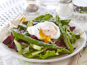 Evesham Asparagus salad with a runny poached egg.