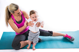 Fitness mother with a baby on the mat.jp