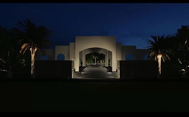 "A destination for a private client, the requirement was purely external lighting. In order to facilitate a ""destination"" theme, lighting is used to explore the whole development. Low-level lighting illuminates roadways to negate breaking the overall view. Facades are illuminated in a classical fashion. Lighting is concealed bringing the estate to life - detailing all the elements that make it unique. The final outcome is a beautiful, subtle & serene destination."