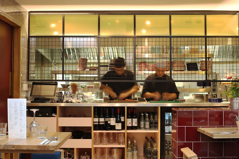Chefs preparing food in modern cafe