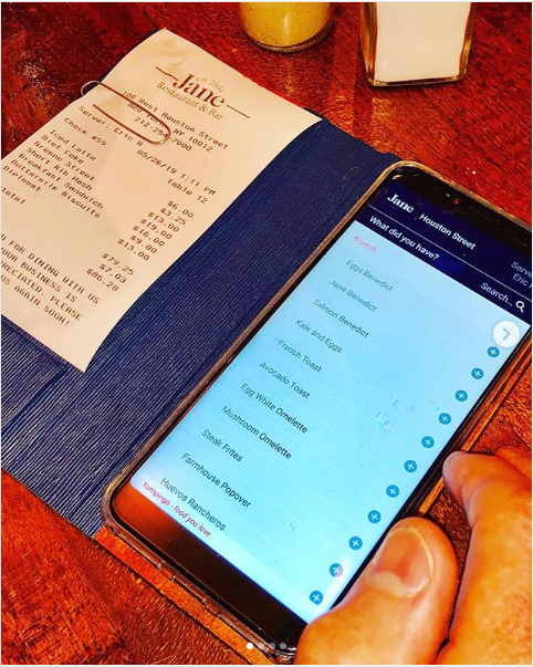 Receipt from Janes Restaurant, and iphone showing customer service response app