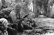 U.S. soldier and Vietnamese civilians ta