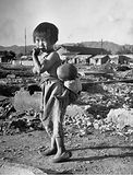 Girl Standing in Rubble from the Korean