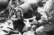 German soldier giving bread to an orphan