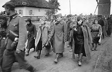 German soldiers lead columns of captured