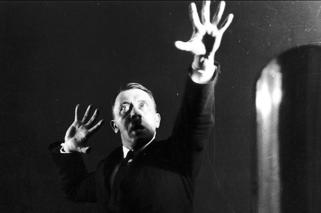 Hitler repeating a speech in front of a
