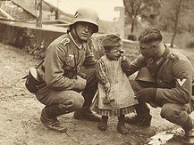 GERMAN SOLDIERS WITH A CHILD