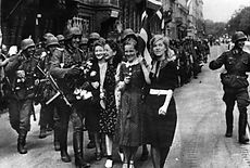 Latvians welcoming Wehrmacht soldiers in