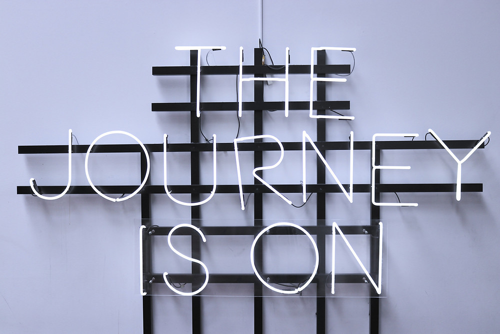 Neon sign saying the journey is on