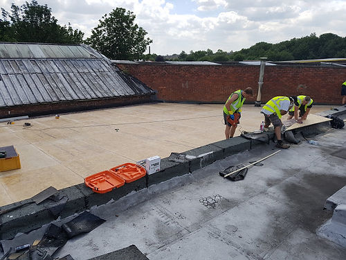 Working hard on a flat roof repair