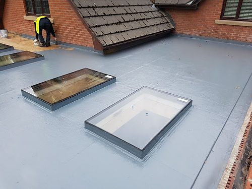 Halfway through a flat roof repair with 5 skylights beng fitted