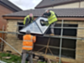 Some of the Ascot Skylights installing a lantern flat roof skylight