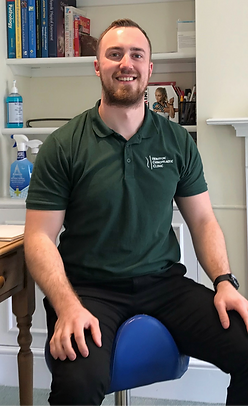 Austin Wells-Burr in treatment room at Honiton Chiropractic Clinic