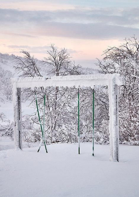 swing in arctic winter landscape