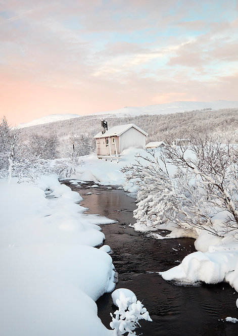 wooden house in arctic winter landscape