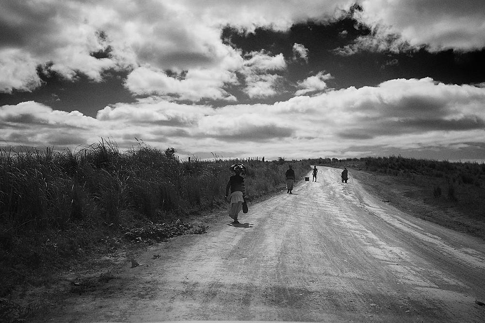 xhosa women walking alon the road in eastern cape