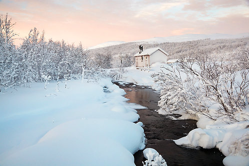 house and river in artic winter landscape