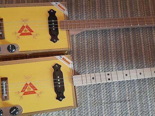Matching Pair of Monte Cristo Guitars