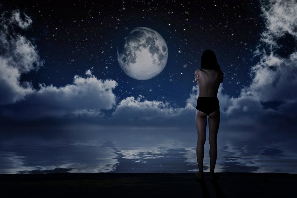 girl-standing-in-front-of-new-moon.jpg