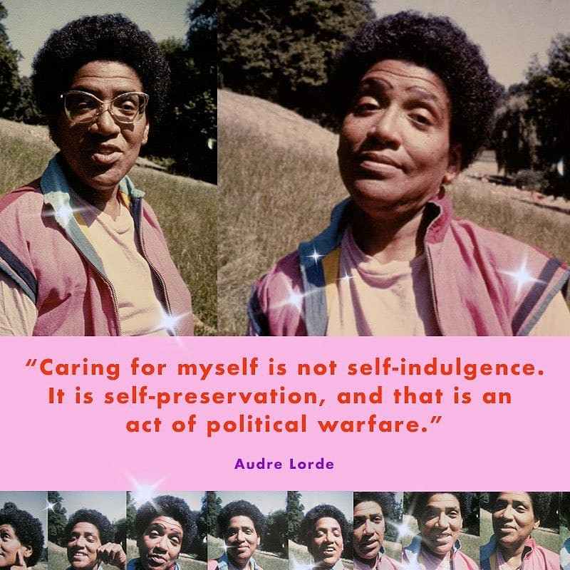 Audre Lorde smiling in nature