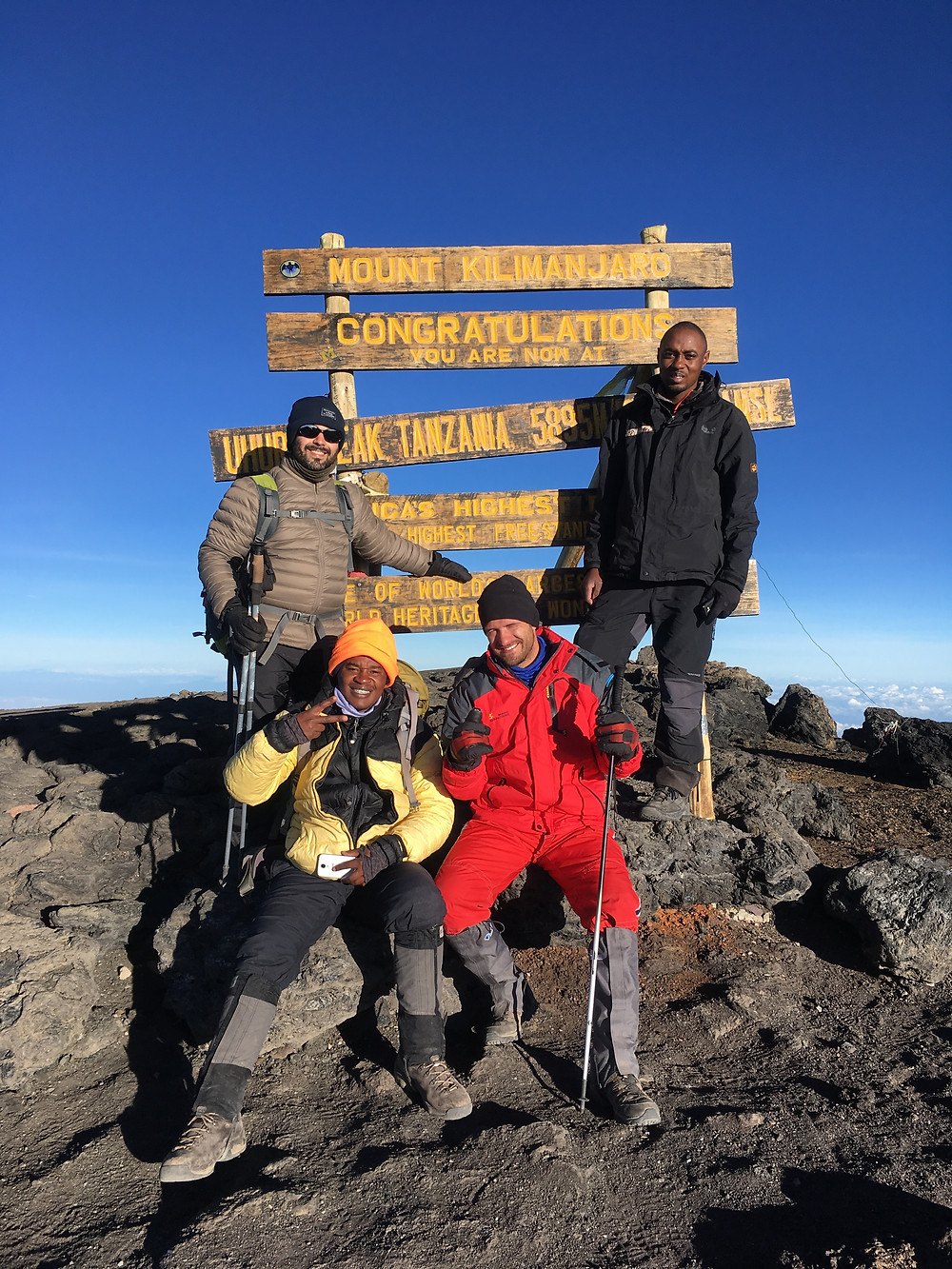 Summiting Mt. Kilimanjaro, top of the world, adventure coaching, life coaching, bucket list