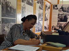 Polish Museum and Archives  (Millennium House) Volunteer, Julia Niziol-Niyazi working on Posters depicting early days of settling into Australia