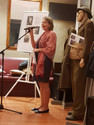 Dorata Preda, Vice Consul representing Polish Consulate Guest speaker for Exhibiition Opening. Uniforms in the background from Polish Land Army and Airforce
