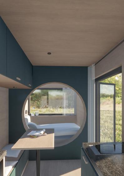 vagabundo mini tiny haus innenansicht wohnraum, bett und küche