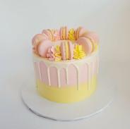 Lemon strawberry drip cake with macarons