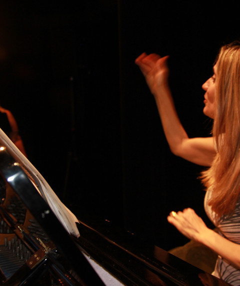 Sharon Conducting from piano