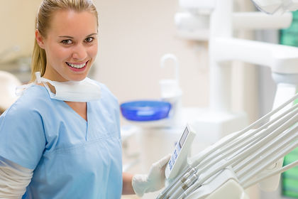 Female dentist with dental equipment at