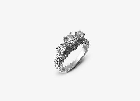Anello-fidanzamento-con-tre-pietre