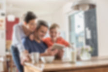 A modern family using a digital tablet w