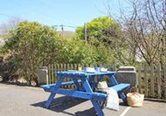 Blue bench outside Wolf Rock, where you can enjoy lunch with a glass of wine