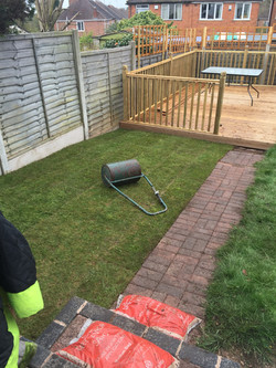 Turf flattened level with roller