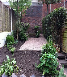 plastic membrane laid in back garden with stone pebbles, weeds disposed of in bags