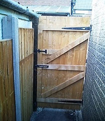 garden gate fitted with new fencing and posts