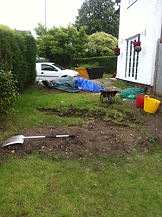 soil wheel barrowed across garden grounds then we raked flat and prepared garden for landscaping