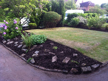 selly oak garden cleaned up of weeds, plastic membrane layed rockeries laid and tree bark barrowed onto borders
