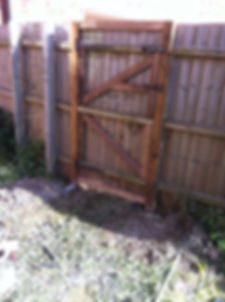 featherboard gate hung on 2 wooden posts