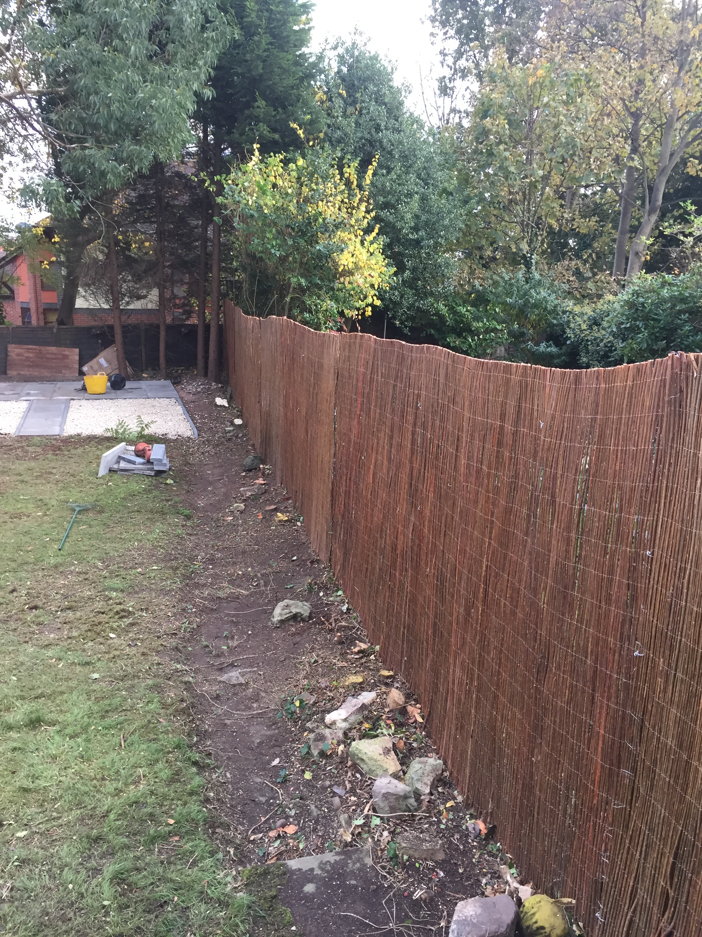 Willow rolls fitted to mesh fence