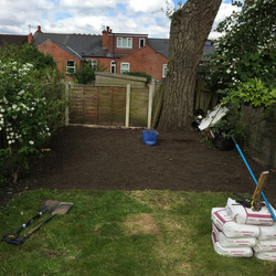 Grass dug up and levelled soil